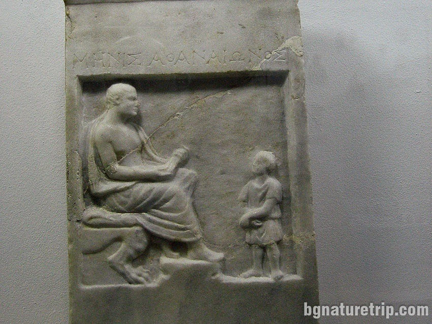 A teacher tells a lesson to a child (3rd Century BC)