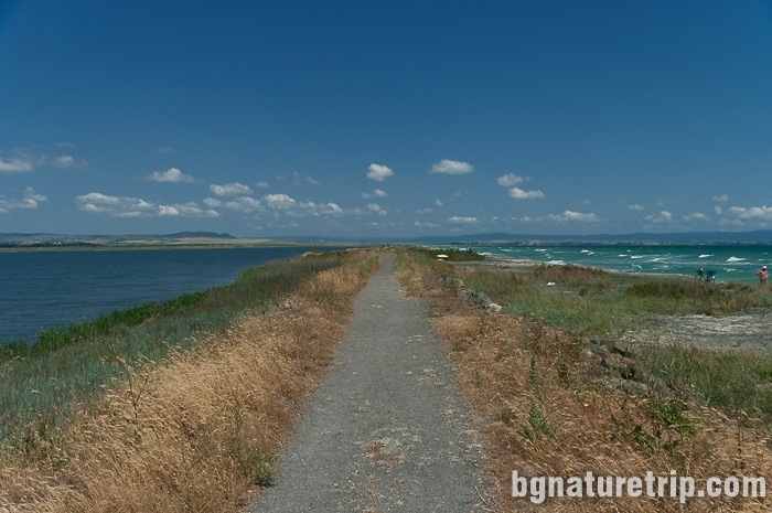The path along the embankment at the sand strip of Pomorie Lake to the town of Aheloy