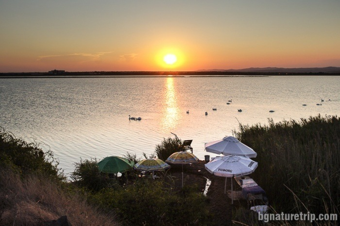 "Sunset over Pomorie Lake. To the left, it is seen the building of the winery ""Black Sea Gold."""