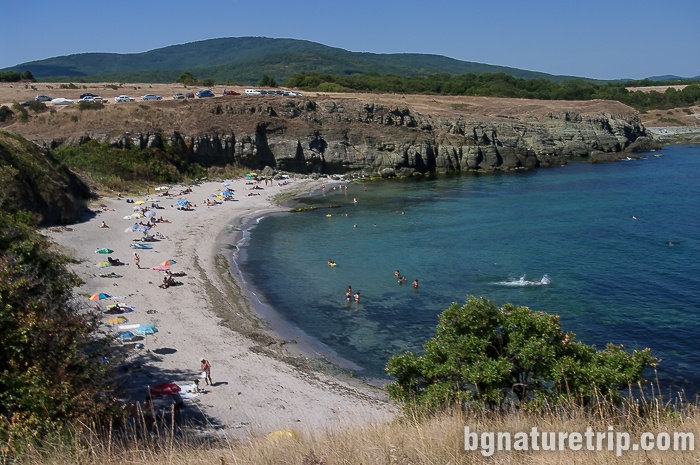 "View of the north of Varvara's beach. Actually, this photo was taken in 2009, and at that time the ""Wake Up Varvara"" bar had not yet been built. The northern end of the beach where ""The Rock"" lays."